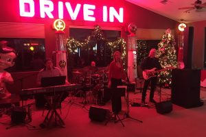 Sound for Carolyn Dolan and Big Red at a company holiday party at Silver Oak Country Club in Carson City.