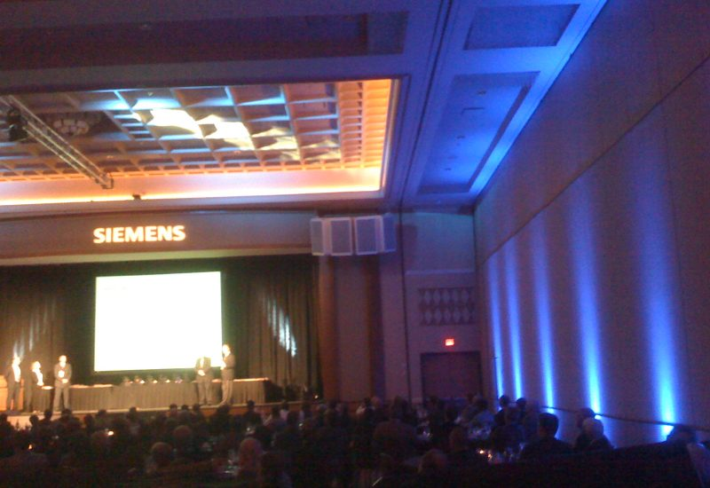 Stage Lighting, Uplighting and Gobo for their logo for a Seimens event.