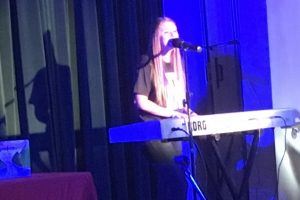 Lizzie Sider playing a Tech Works Korg Triton Workstation keyboard