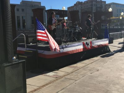 The Run Up playing on a patriotically decorated 20x8' stage before an election debate event.